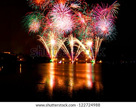 fireworks over water - stock photo