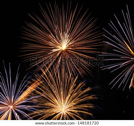 Fireworks stars in night sky - stock photo