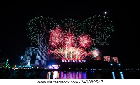 Fireworks with reflections at Pattaya Gulf, Chonburi Province, Thailand 2014