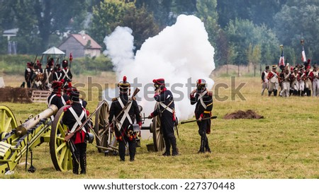 Firing cannons at the reenactment of the Battle of Wavre 1815. This blocking action kept the French soldiers from reaching Waterloo. The battle helped the Allied forces defeat the French army. - stock photo