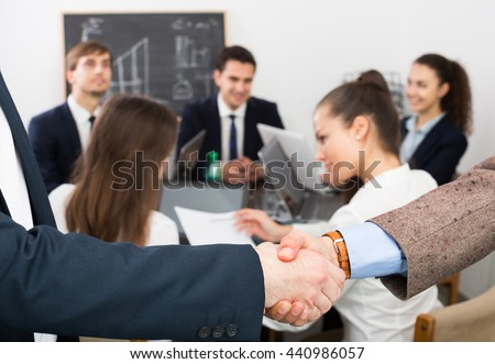 office meeting pictures. firm handshake between two successful business partners at a office meeting pictures