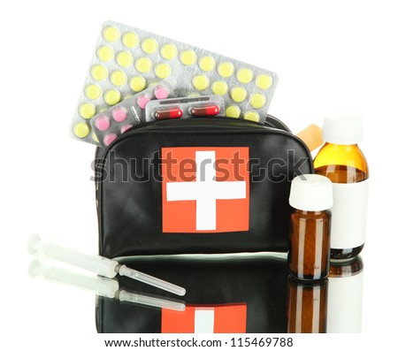 First aid bag, isolated on white - stock photo