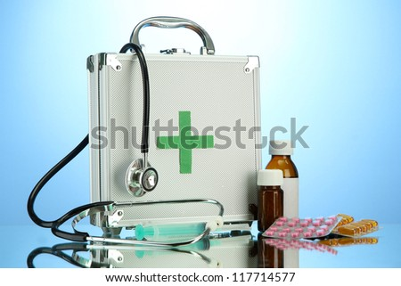 First aid box, on blue background
