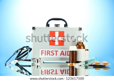 First aid box, on blue background - stock photo
