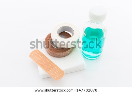 First aid kit for bandaging isolated on white background - stock photo