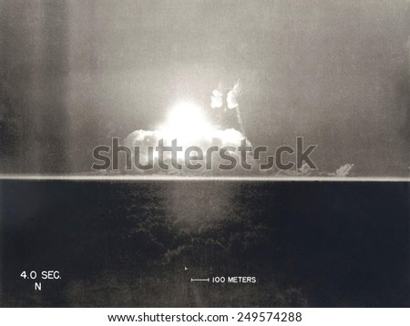 First Atomic Explosion on July 16, 1945. Photograph taken at 4 seconds after the initial Trinity detonation shows the beginning of the Mushroom cloud. Manhattan Project, World War 2. - stock photo