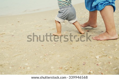 first baby's steps  - stock photo
