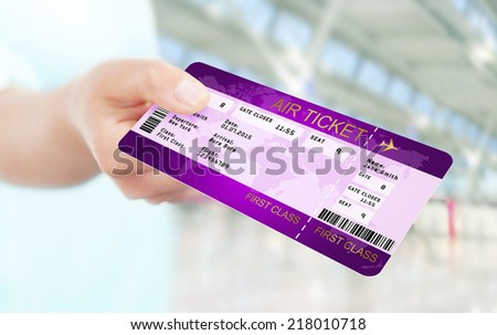 first class fly ticket holded by hand. focus on ticket - stock photo