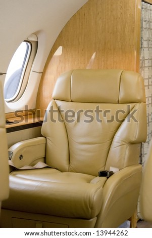 First Class Seat on Corporate Jet Waiting for a Passenger - stock photo