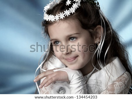 First Communion beautiful girl in white dress