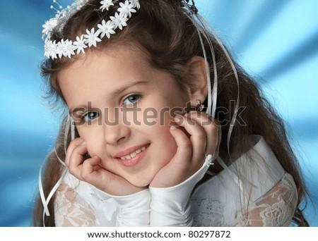 First Communion beautiful girl in white dress - stock photo