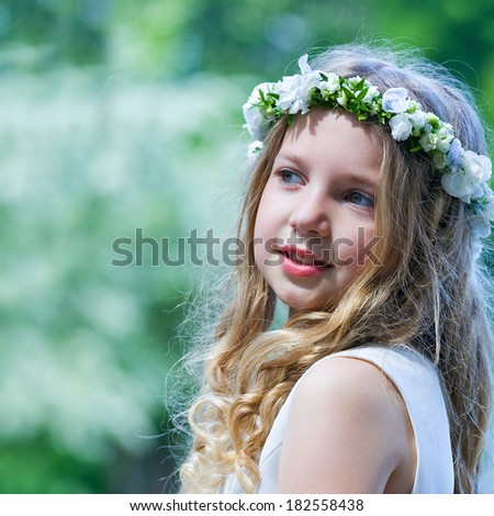 First Communion beautiful girl on green background - stock photo