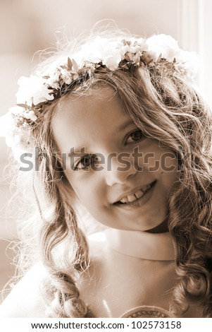 First Communion beautiful girl - sepia - stock photo