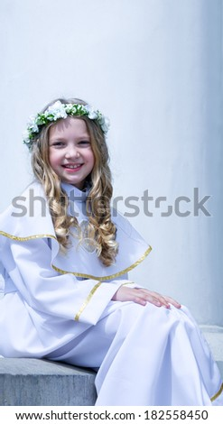 First Communion beautiful young girl on the white background - stock photo
