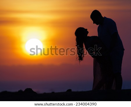 First date of a couple at background silhouette