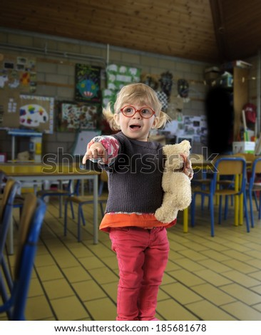 first day in kindergarten, with teddy bear - stock photo