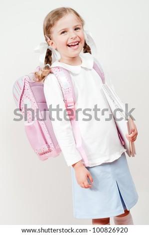 First day of school - portrait of adorable schoolgirl - stock photo