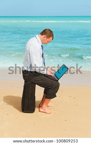 First day of vacation.Businessman  on the beach