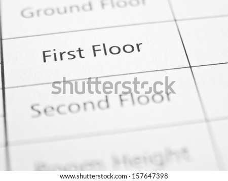 FIRST FLOOR written on a form or contract close up.