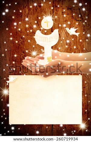 First Holy Communion invitation, Chalice and wafer in the hands of a child, and copy space to customize - stock photo