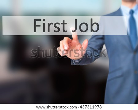 First Job - Businessman hand pressing button on touch screen interface. Business, technology, internet concept. Stock Photo