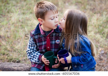 First kiss little boy little girl stock photo edit now 605567036 first kiss little boy and little girl kissing in the forest altavistaventures Images