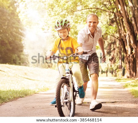 First lessons bicycle riding - stock photo