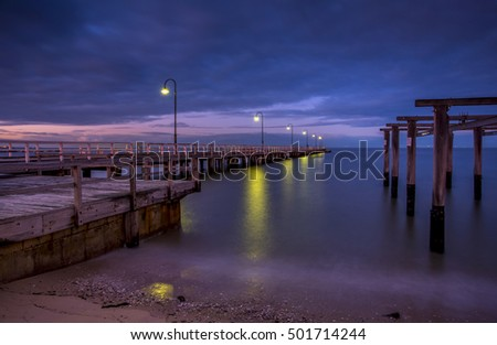 first light Dawn sky city Port Melbourne bay beach sunrise pier reflections lampposts