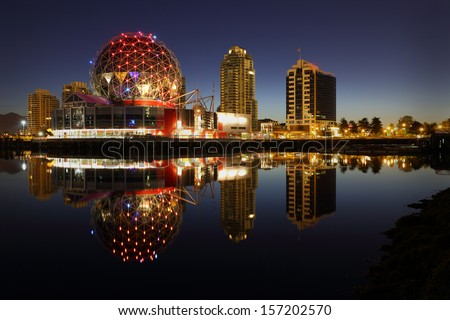 First Light False Creek Dawn, Vancouver. False Creek and the Vancouver skyline at dawn. The geodesic dome is a local landmark. British Columbia, Canada.  - stock photo