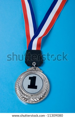 First place medal on blue background
