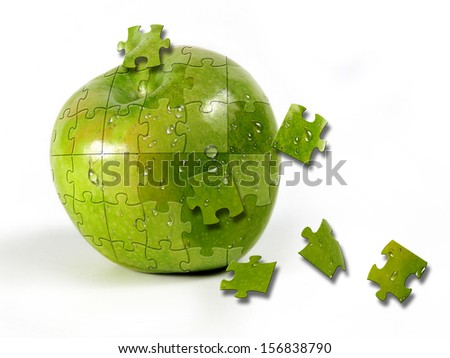 first plane of green apple formed by puzle pieces     - stock photo