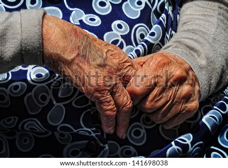 first plane of the hand of an old man - stock photo