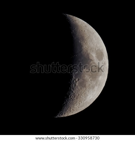 First quarter moon over dark black sky (picture taken with my own telescope, NO NASA images used) - stock photo