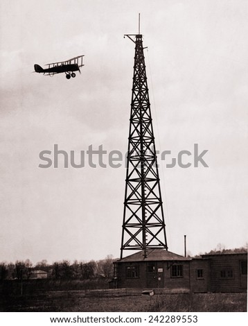 First radio beacon station, with the operating shack and antenna system at College Park, Maryland. Airplane used the radio signals for navigation. 1928.