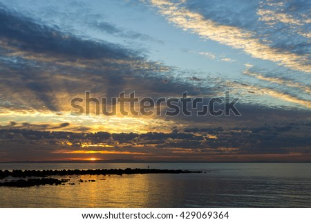 First rays of light on a winter day over the Moreton Bay, Queensland, Australia - stock photo