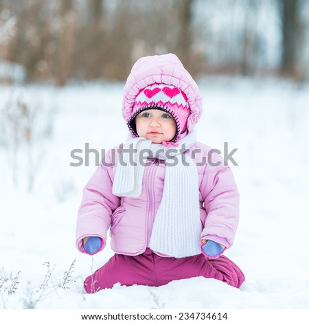 first snow. little girl enjoys the arrival of winter - stock photo