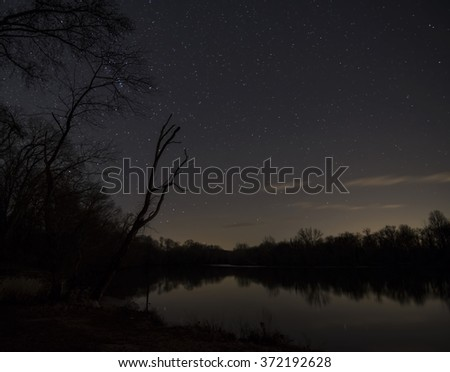 First stars of the night over the river