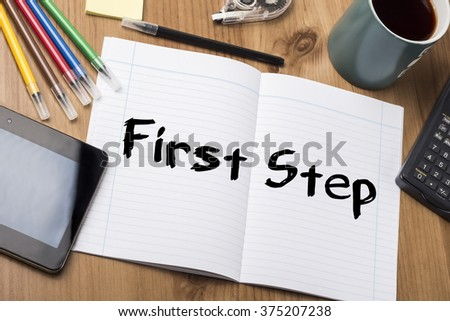 First Step - Note Pad With Text On Wooden Table - with office  tools