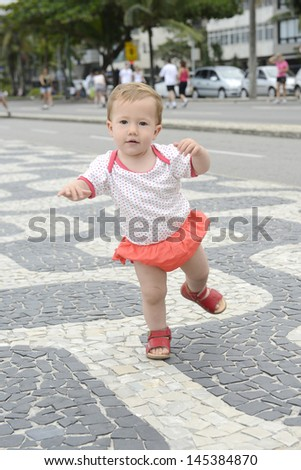 First steps: Cute baby walking - stock photo