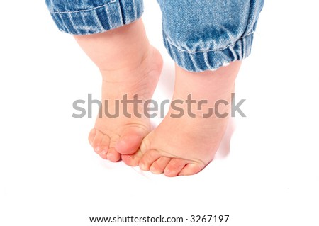 first steps of a little boy - stock photo