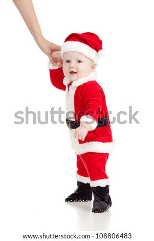 First steps of Santa claus baby. Studio shot