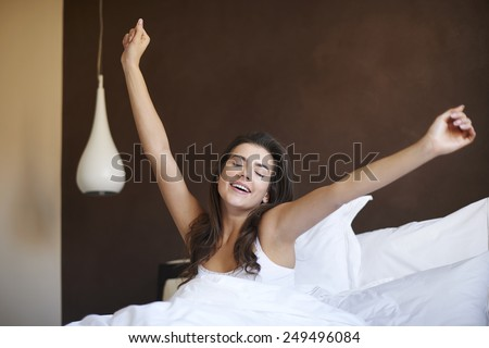 First stretching after great night  - stock photo