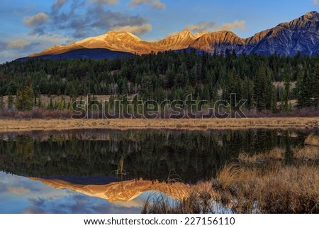 First sunlight on Pyramid Mountain peak - stock photo