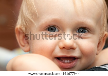 First teeth in a young boy's mouth. Happy child. - stock photo