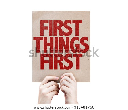 First Things First cardboard isolated on white - stock photo