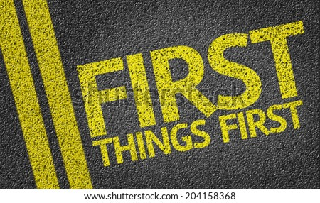 First Things First written on the road - stock photo