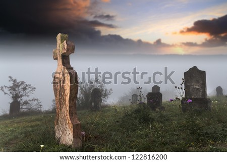 First trek of dawn in the old cemetery - stock photo