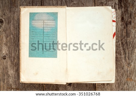 First two pages of a vintage library book with due date card.  - stock photo