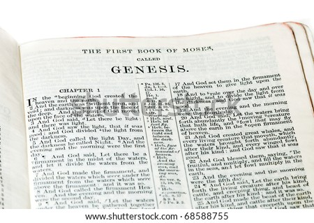 First verses of the Book of Genesis from an old family King James Bible. Includes the title.  On white.