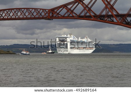 FIRTH OF FORTH, SCOTLAND - SEPTEMBER 2 2016: Princess Cruise Ship, Caribbean Princess, with the Forth Rail Bridge in the foreground
